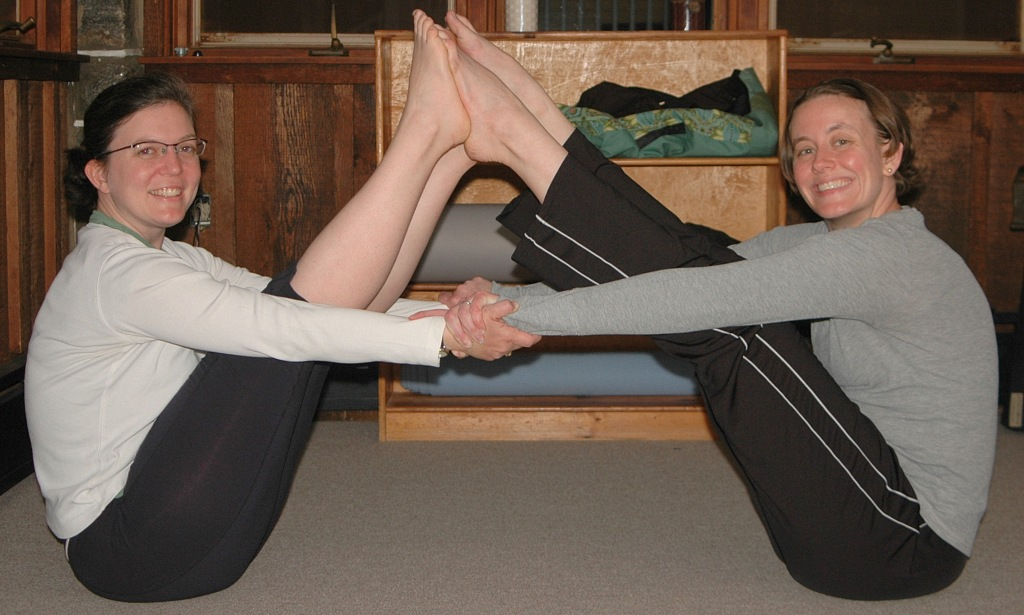 Partner-Assisted Boat Pose