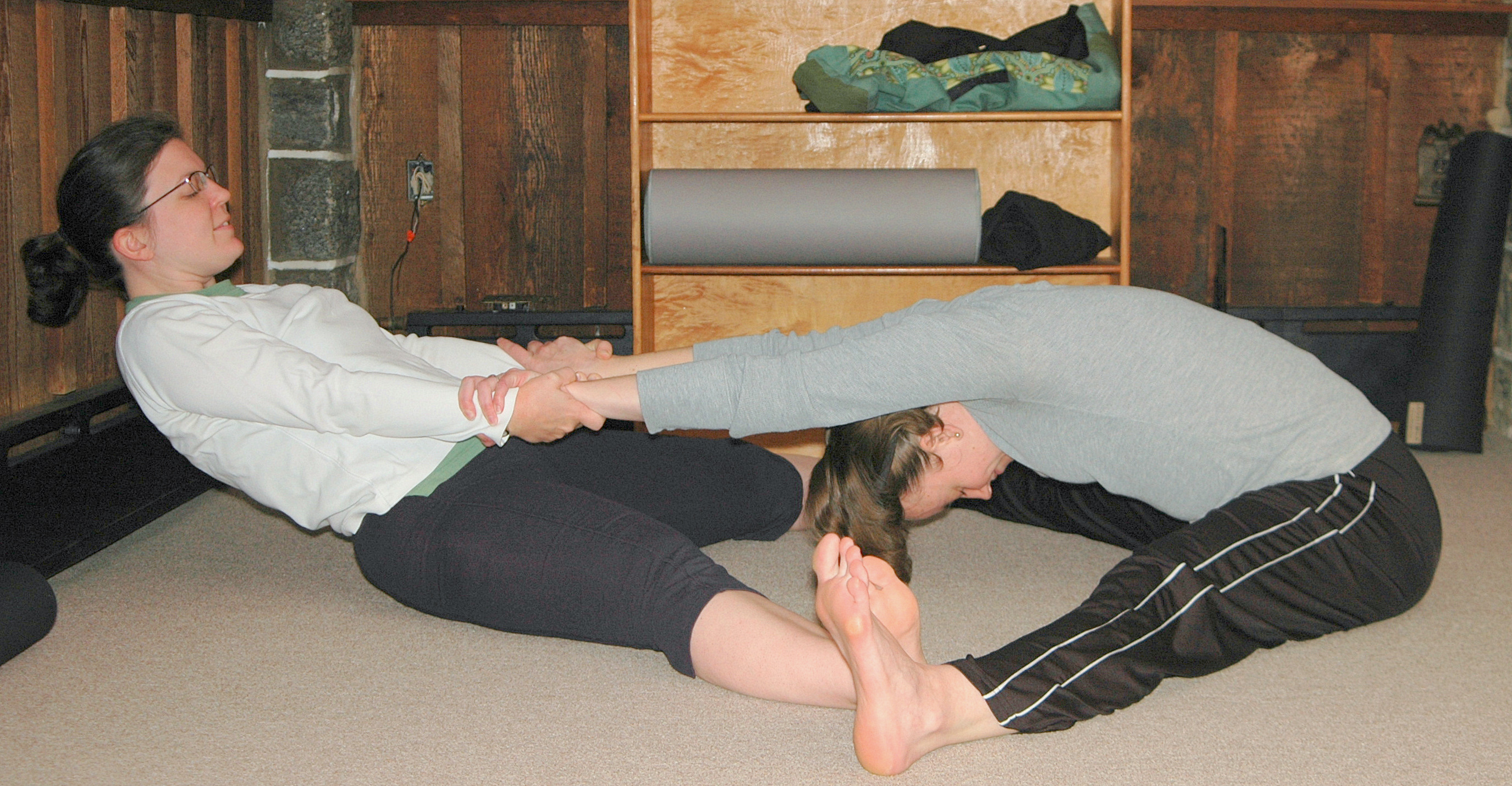 Pose Of The Month Partner Assisted Wide Legged Forward Fold Rox Does Yoga